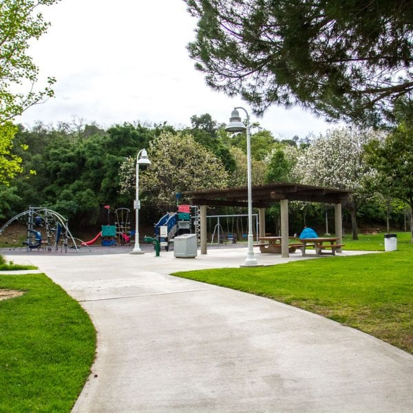Path to a playground, swings and picnic tables