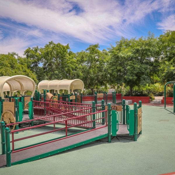 Playground with wagon-style tunnels
