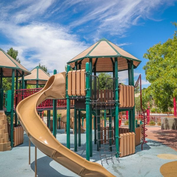 Playground with long slide wrapping around