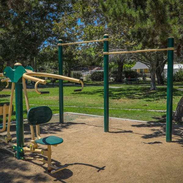 Exercise equipment among grass and trees