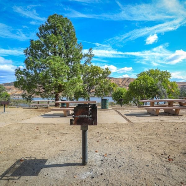 Picnic tables, BBQ grills and trash cans