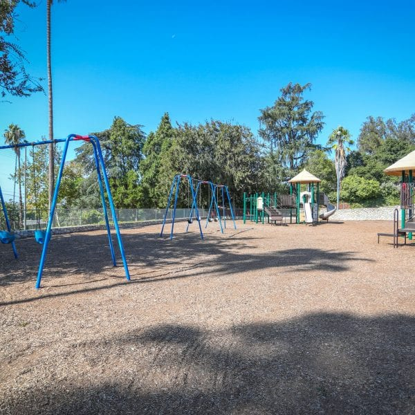 Swing sets and playground structures on a wood chip bed