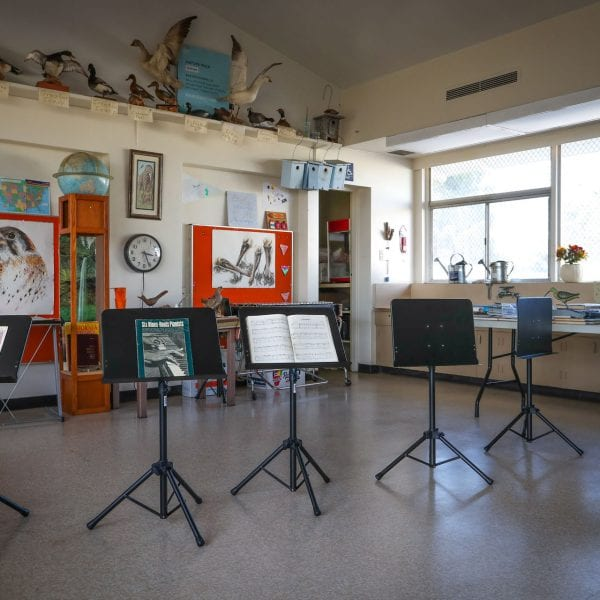 Classroom with music sheets and other educational objects