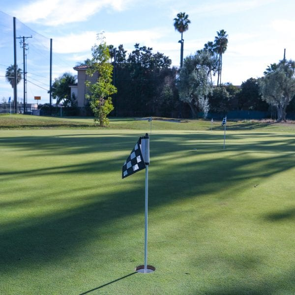 Hole flag in a golf field