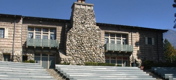 stone building with outdoor bench seating
