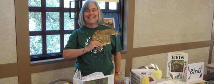 LA County volunteer with bird wing in hand
