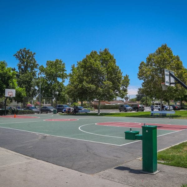 Outdoor basketball court with a drinking fountain