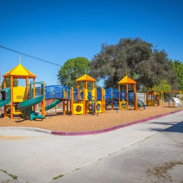 Chain of playgrounds, benches to the right