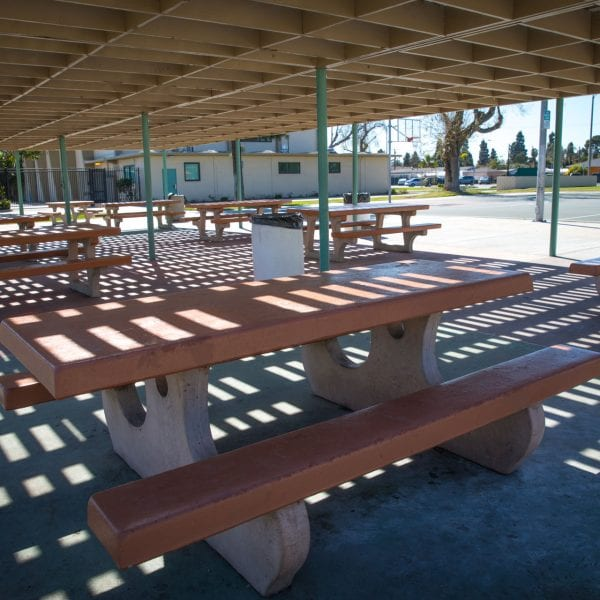 Adobe picnic tables under an awning