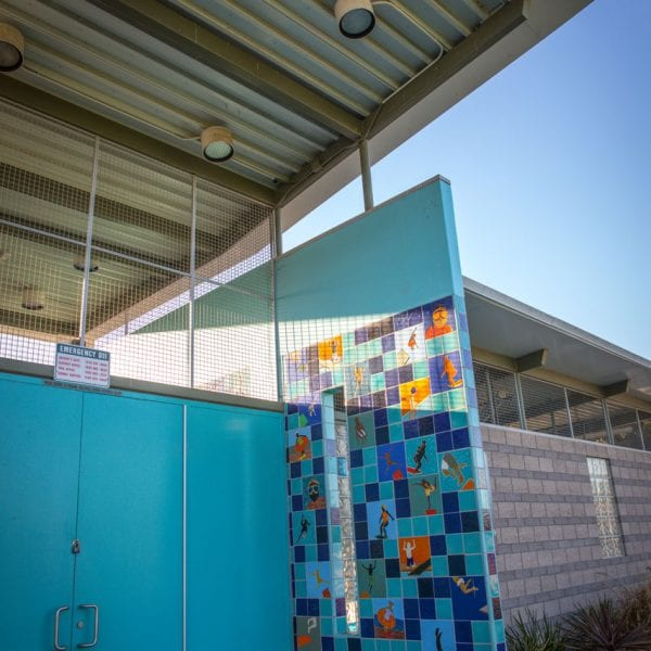 Colorful tile wall on pool building