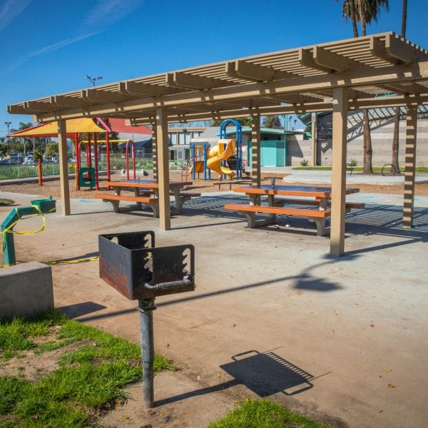 BBQ grills, awning over picnic tables and playground