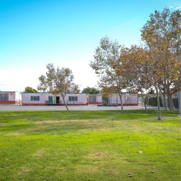 Grass field and classrooms