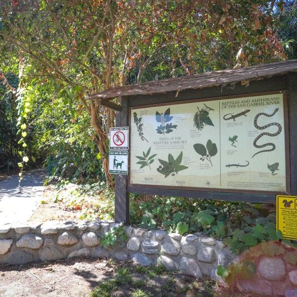 Informational sign next to garden walkway