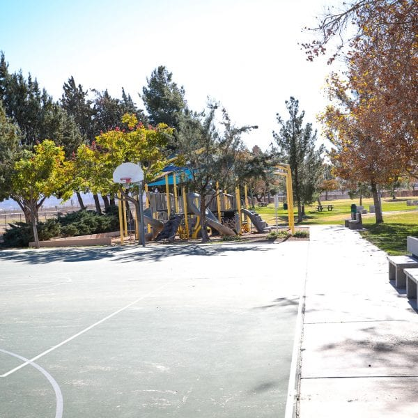 Basketball court, benches and playground