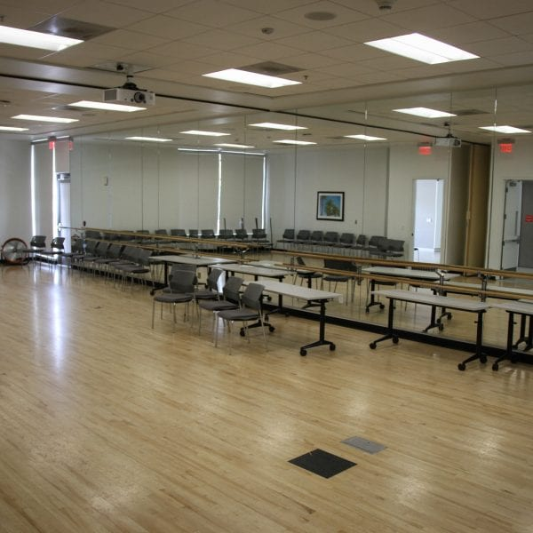Room of tables with computers
