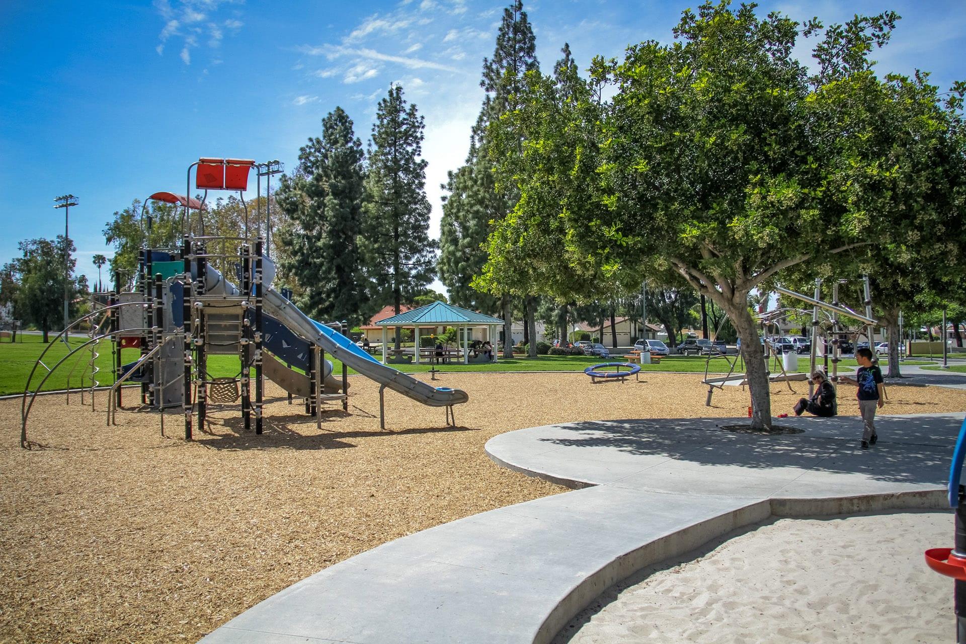 Playground next to a concrete walkway