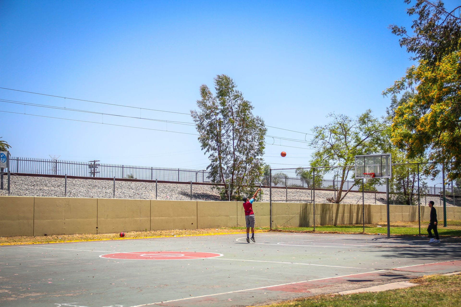 Young man shooting a hoop on a basketball court