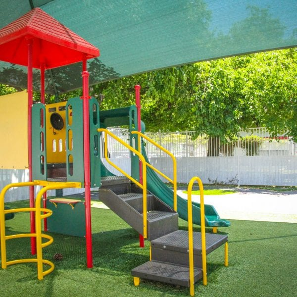 Playground on an artificial grass turf