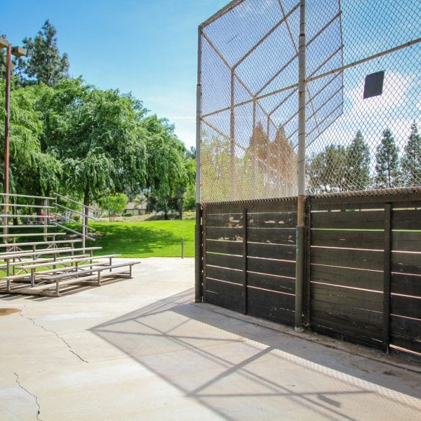 Bleachers to the side of the baseball net