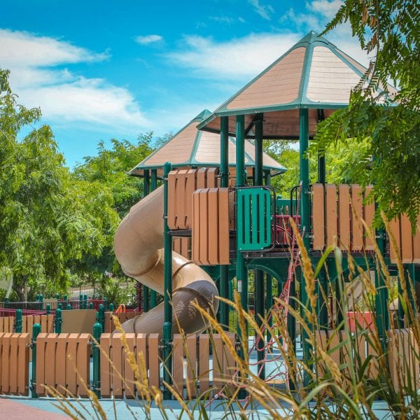 Playground with tall grass in foreground