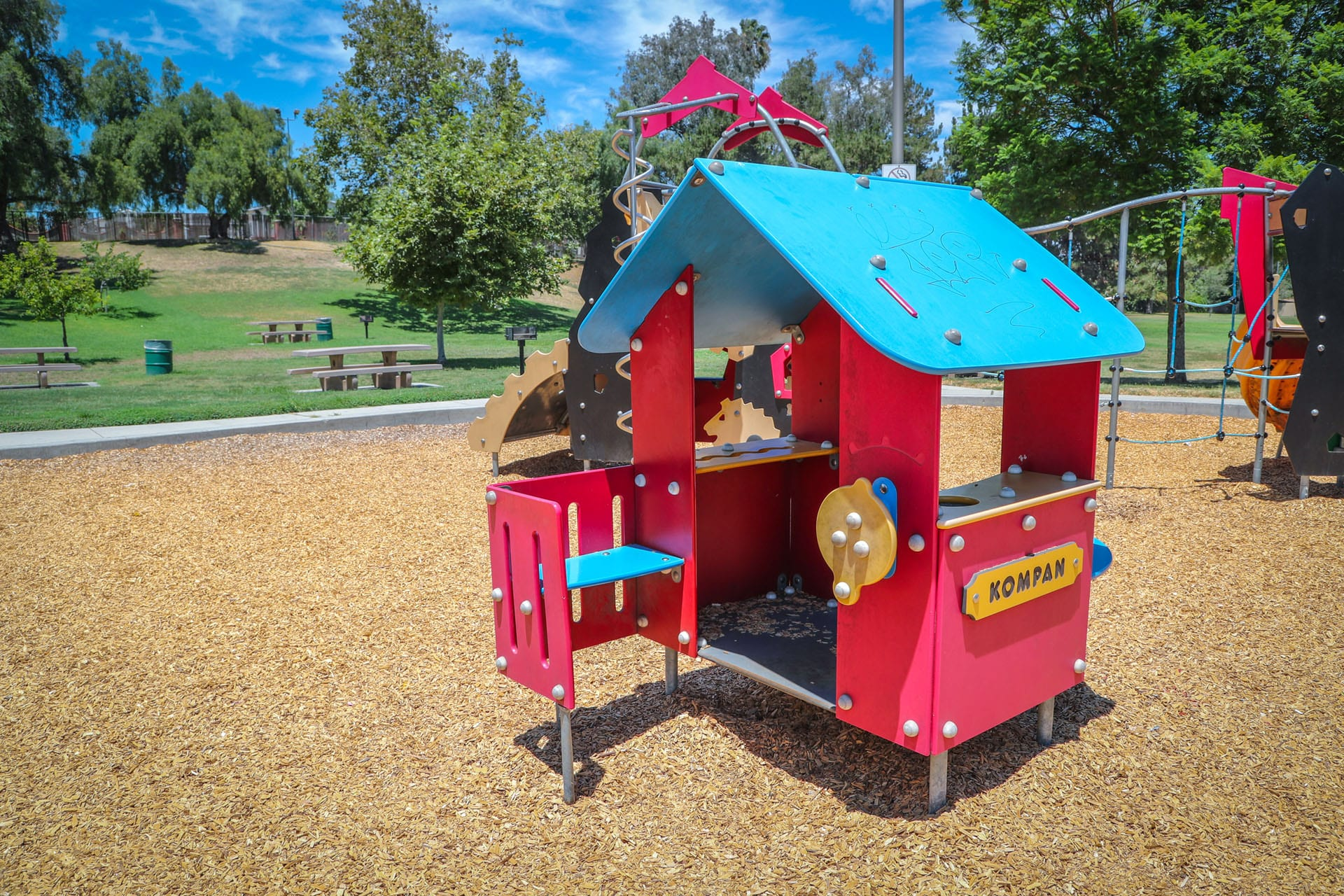 Playground unit on a wood chip bed