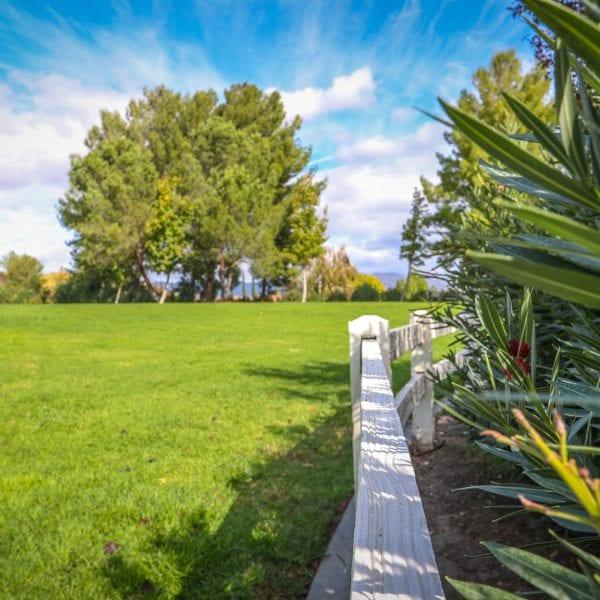 Fence around a garden next to a lawn