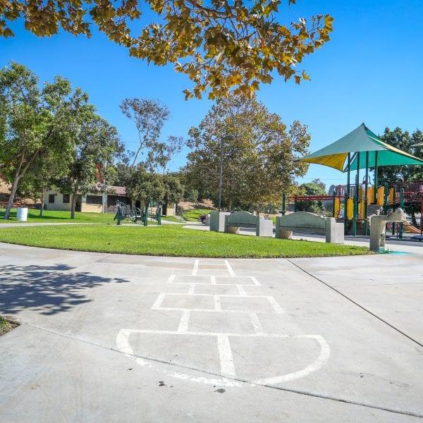 Hopscotch track on concrete near playground