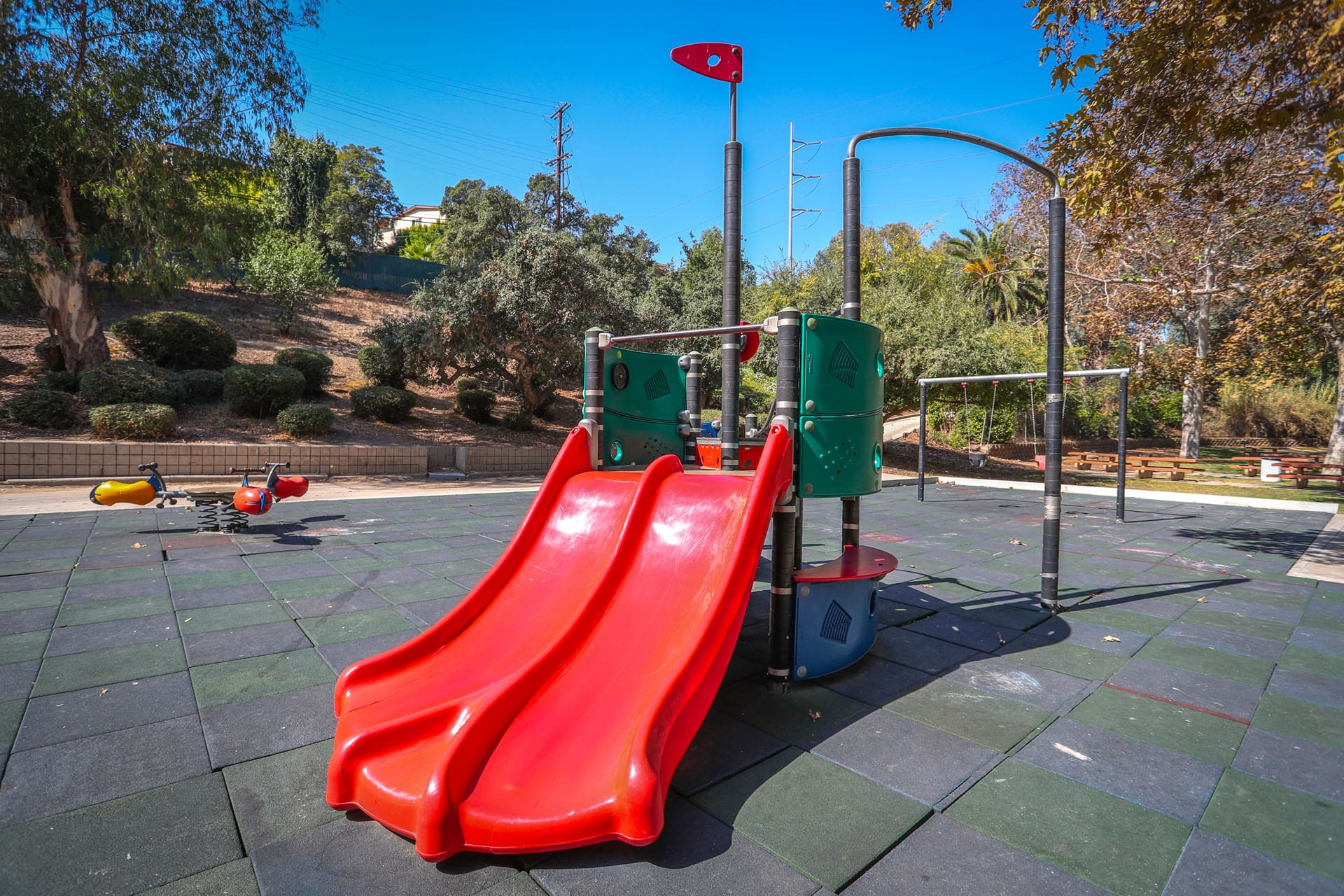 Playground on a rubber tile turf