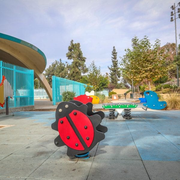 Spring-loaded playground rides