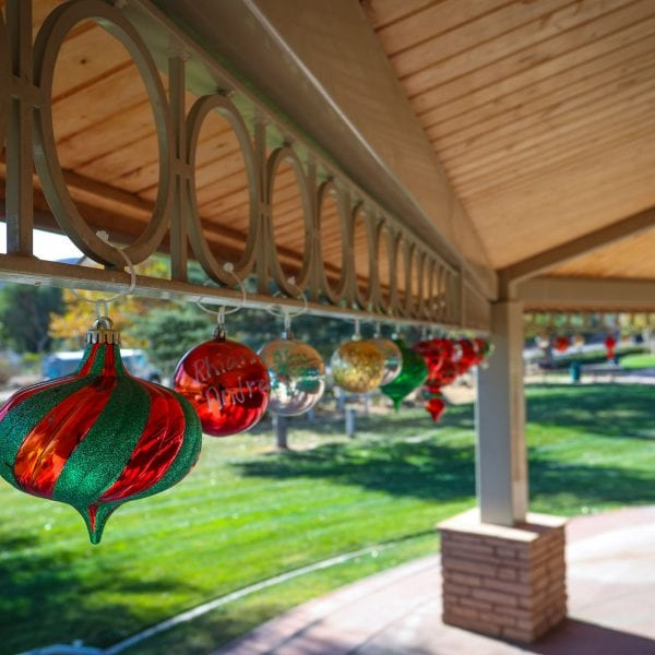 Green and red ornaments hanging from an awning