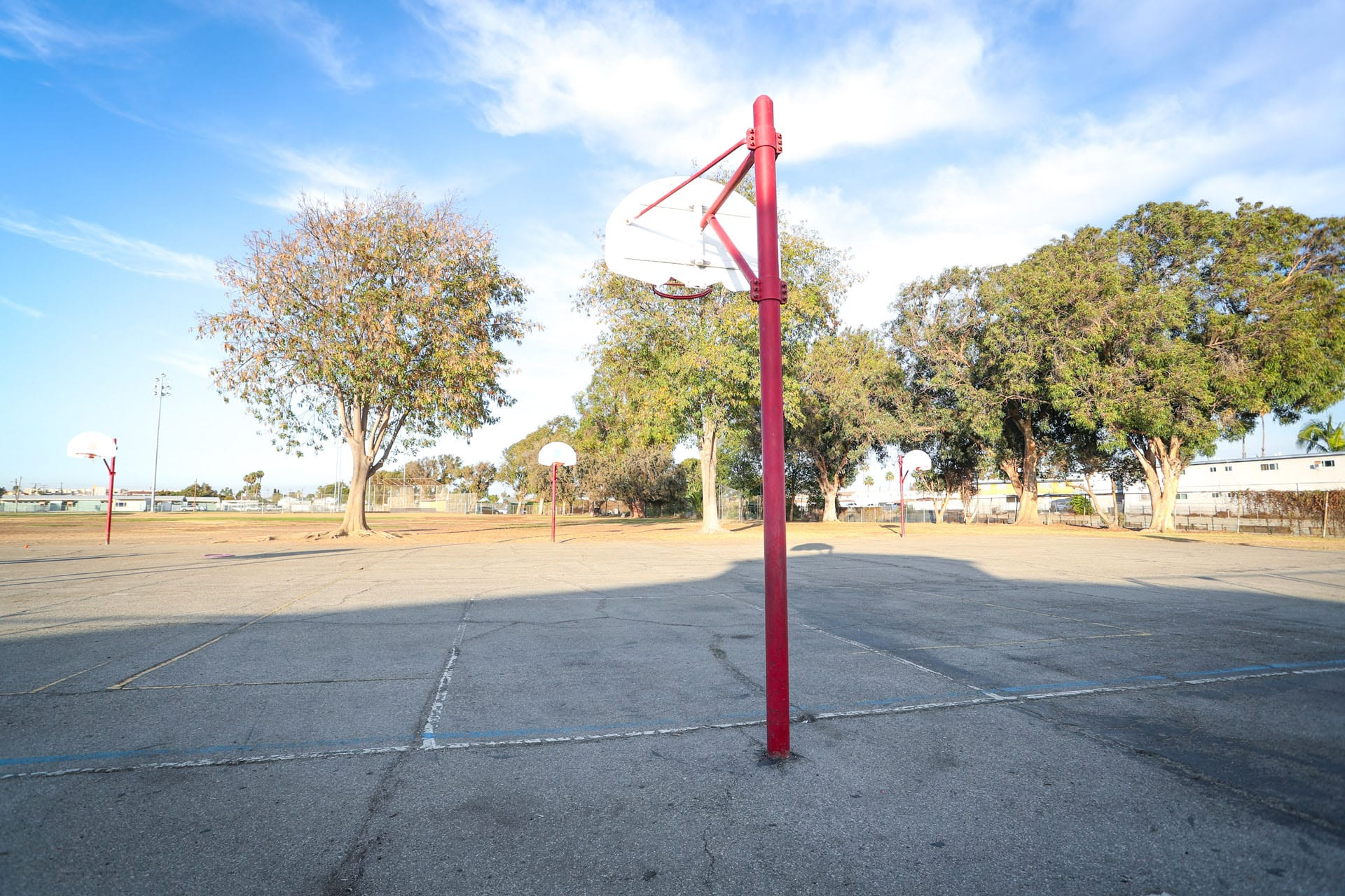 Basketball courts with hoops on red posts
