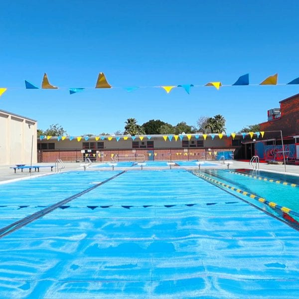Outdoor swimming pool with flags overhead