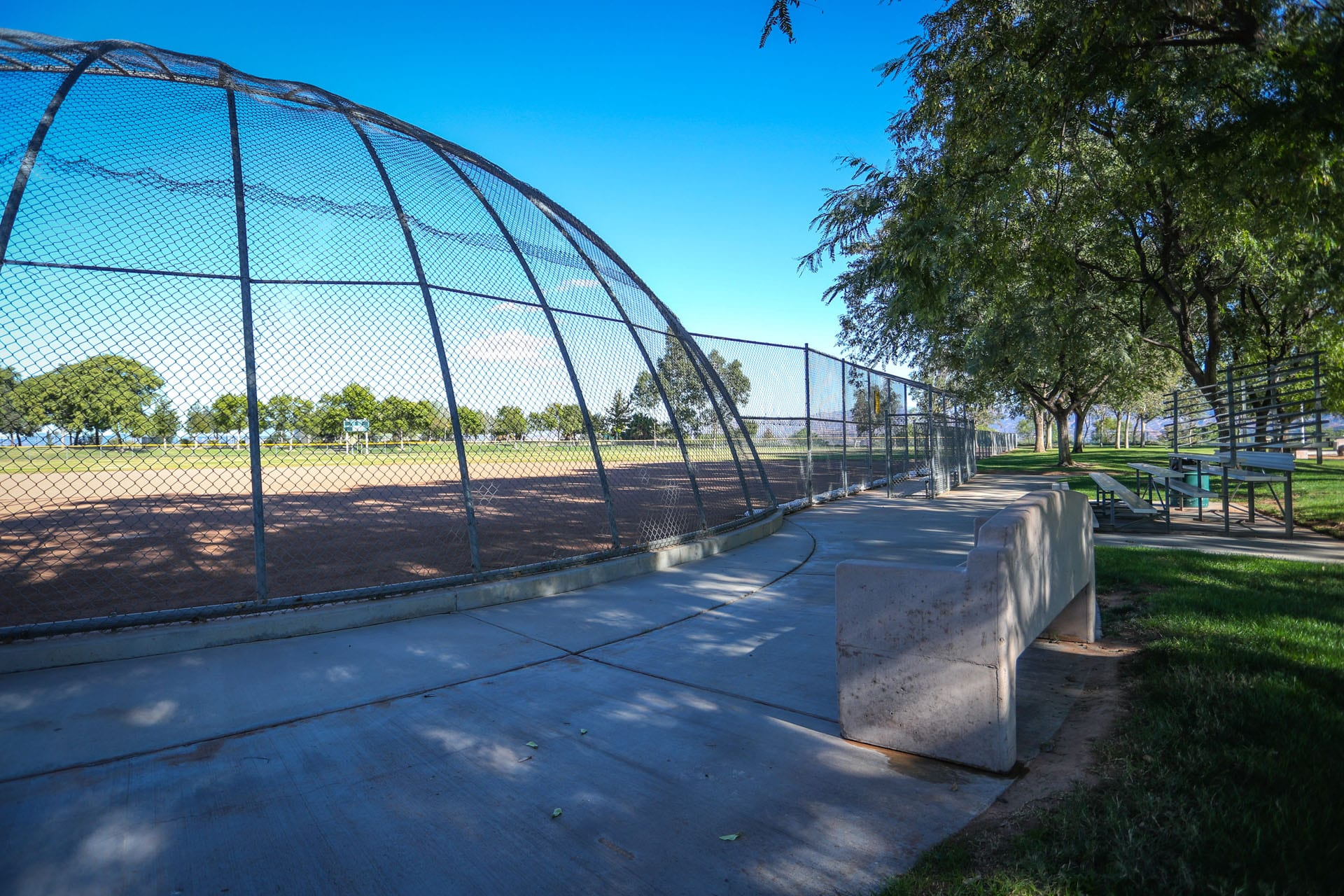 Baseball net with bench outside
