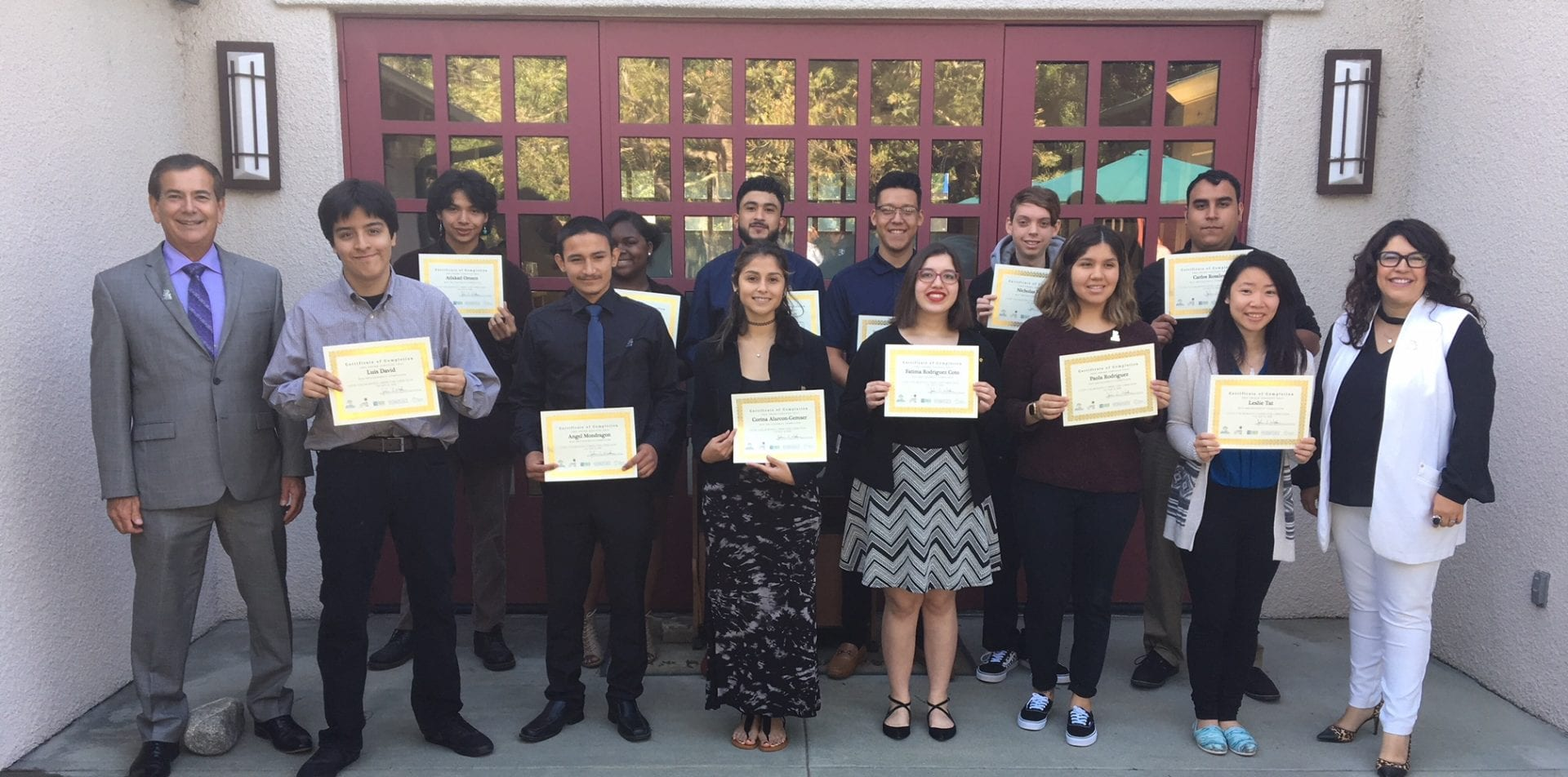 Group photo. Students holding certs