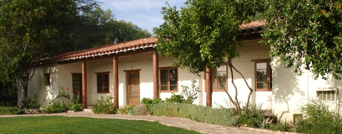 old adobe house with small garden