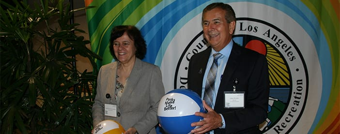 park and recs director with woman holding beach balls
