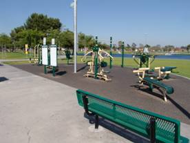 yellow and green fitness zone station in a park