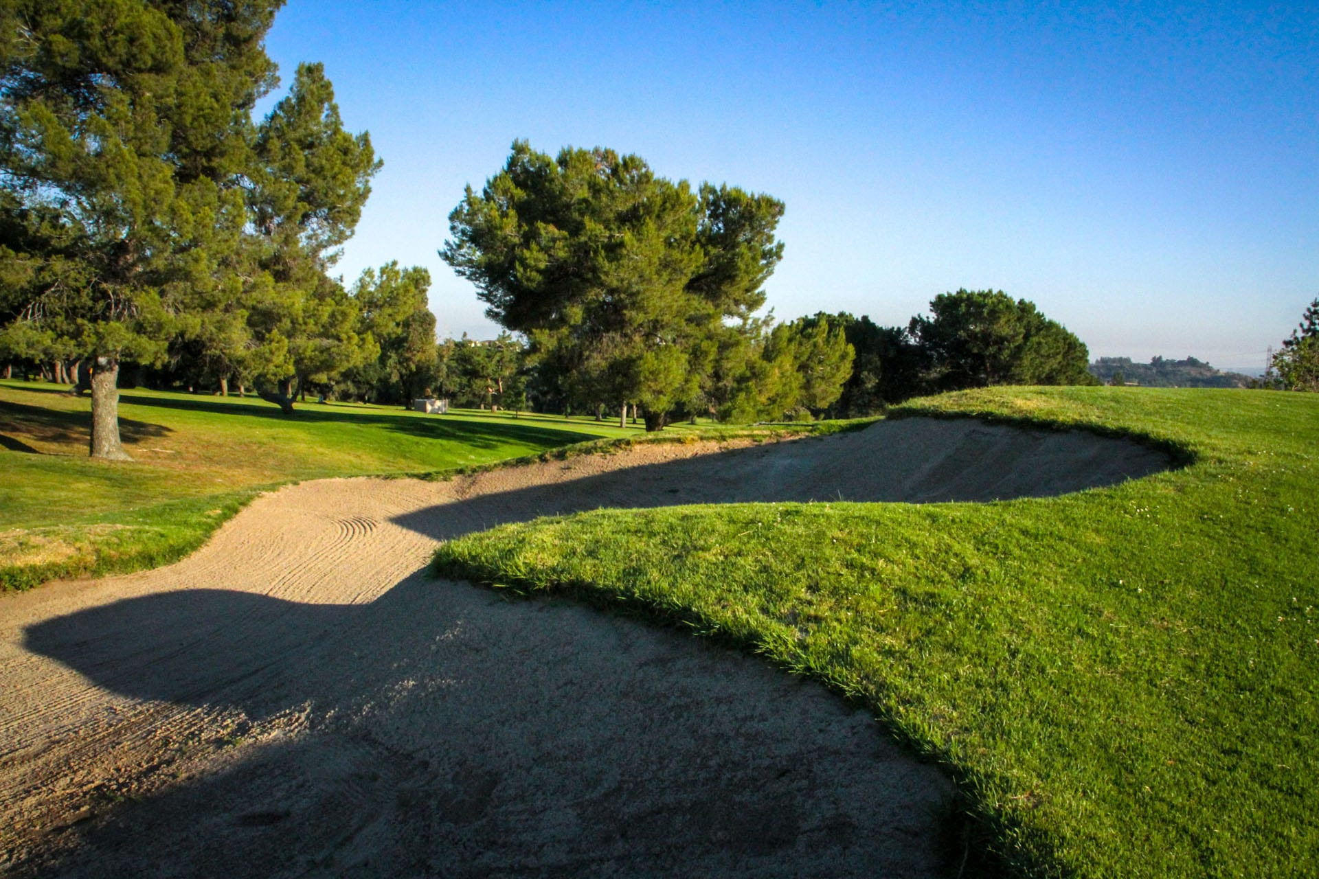 Large sand trap just over a hill