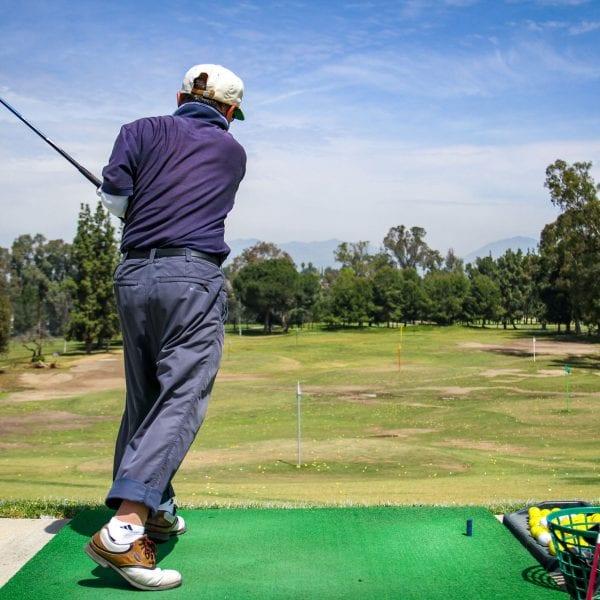 Man hitting a golfball