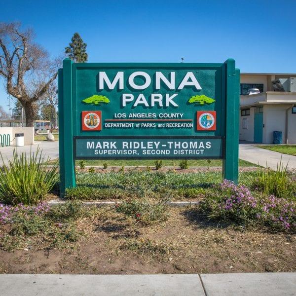 Mona Park sign in flower garden
