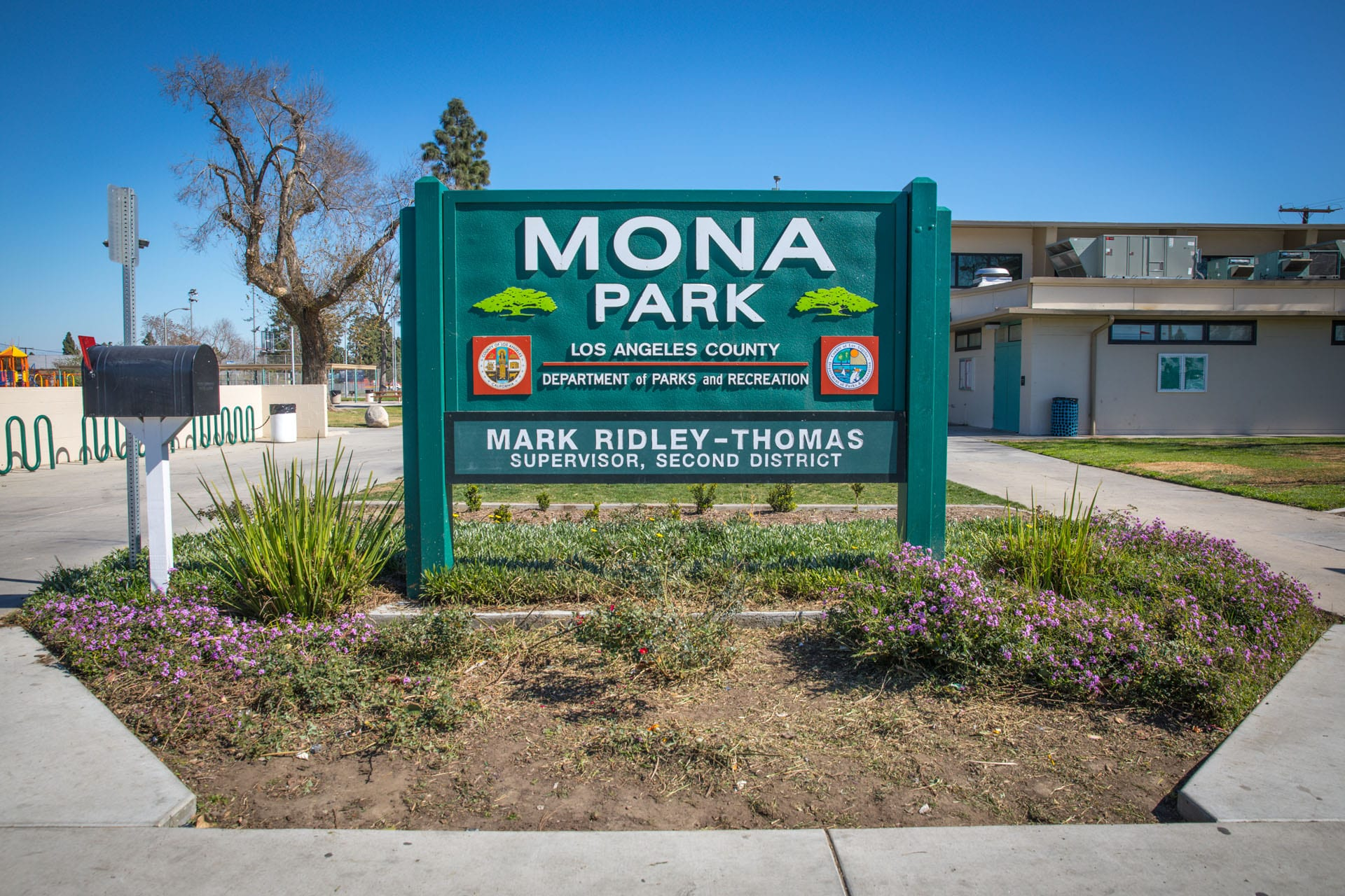 Mona Park sign in flower garden