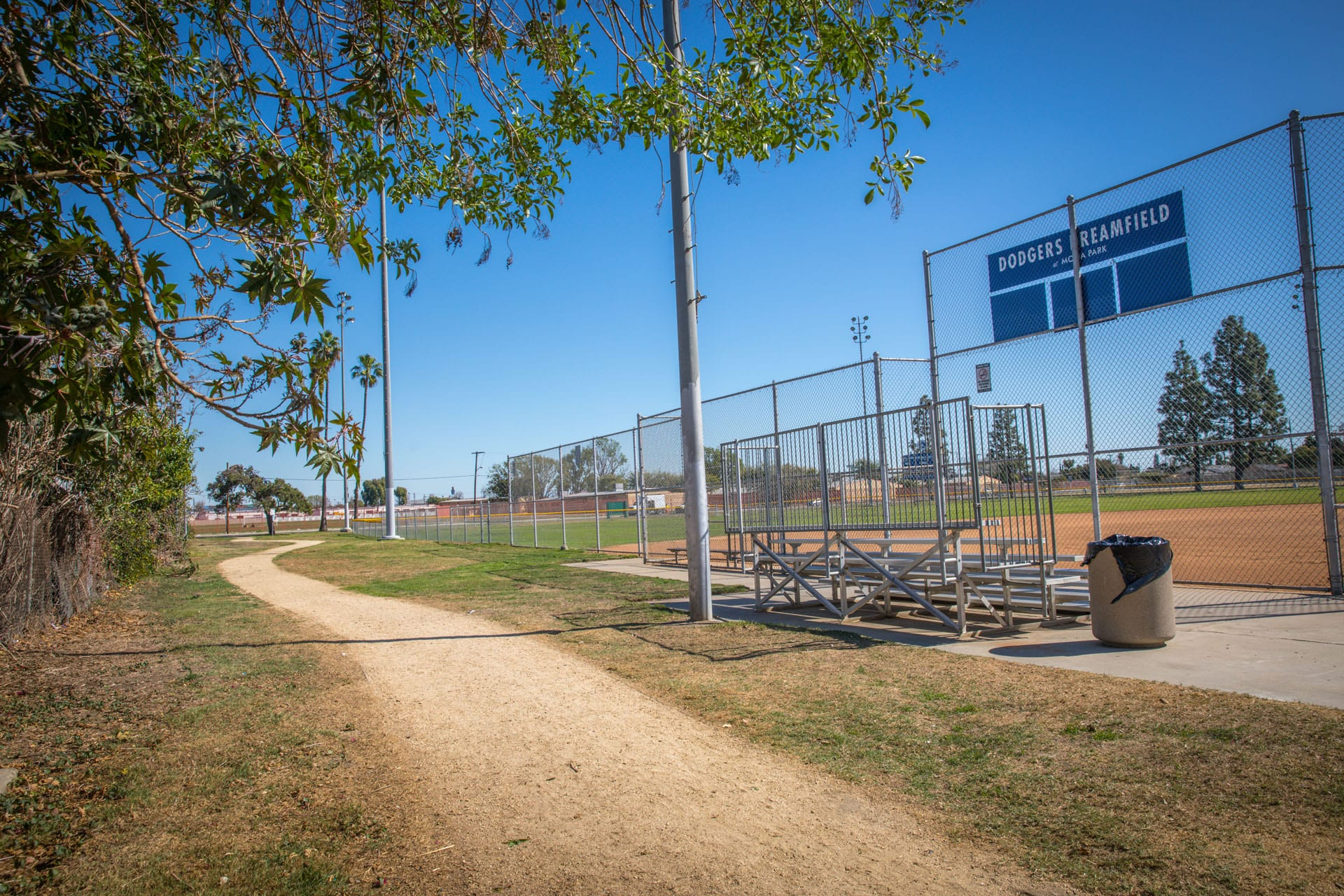 Trail running along side a baseball field