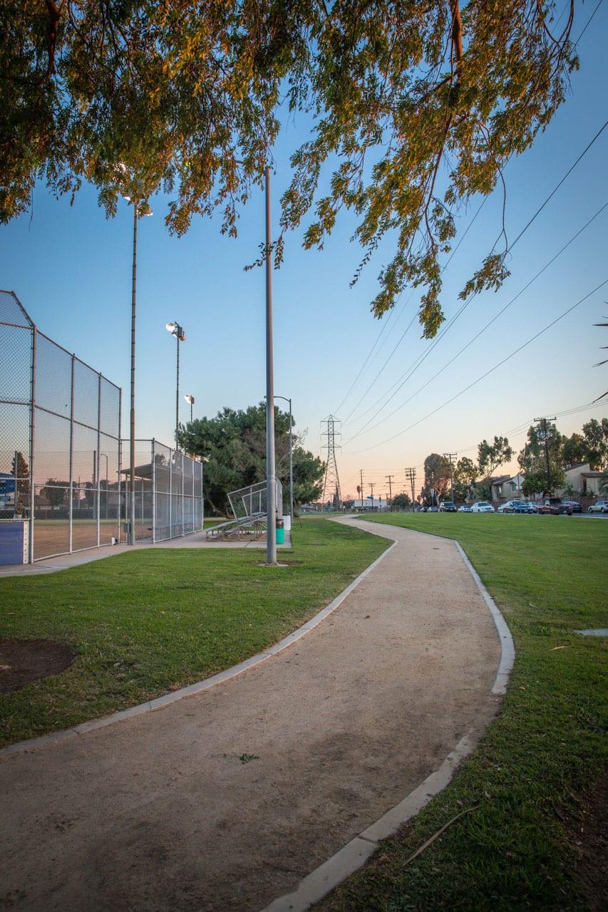 Dirt trail wrapping a baseball field