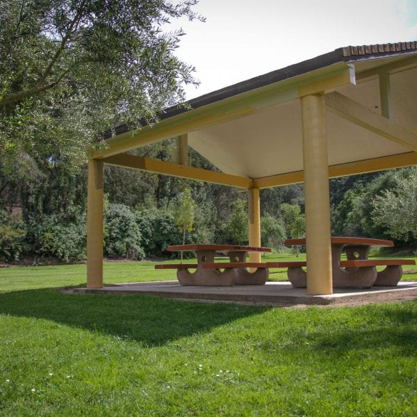 Awning shading two picnic tables