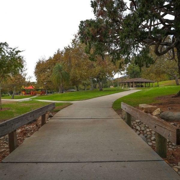 Concrete walkway through park