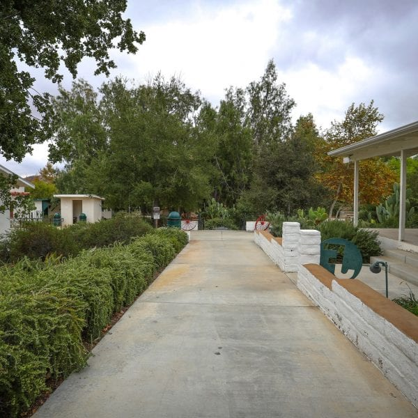 Concrete walkway running between facilities