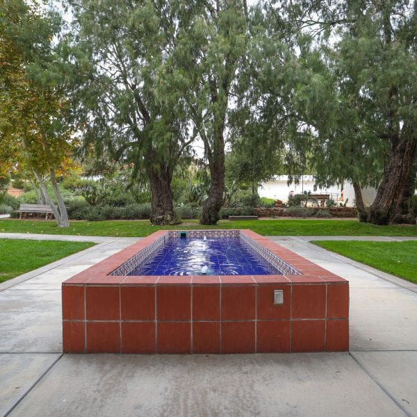Water fountain next to walkway