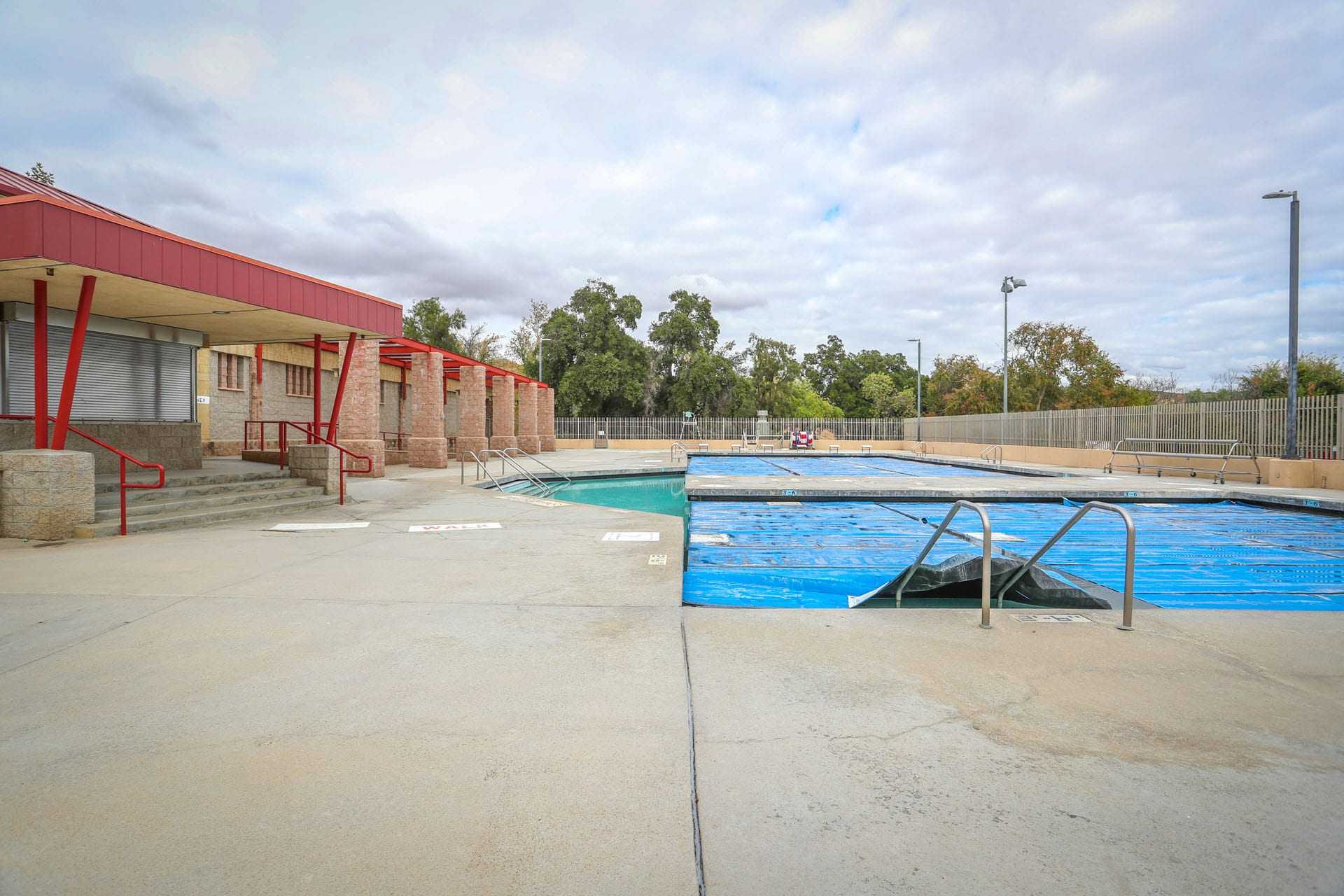Outdoor pool next to facility