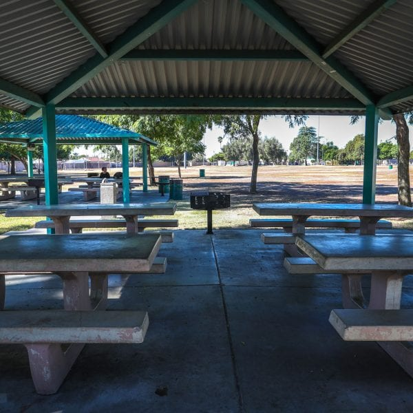 Picnic tables under awnings. BBQ grills on outer parameters