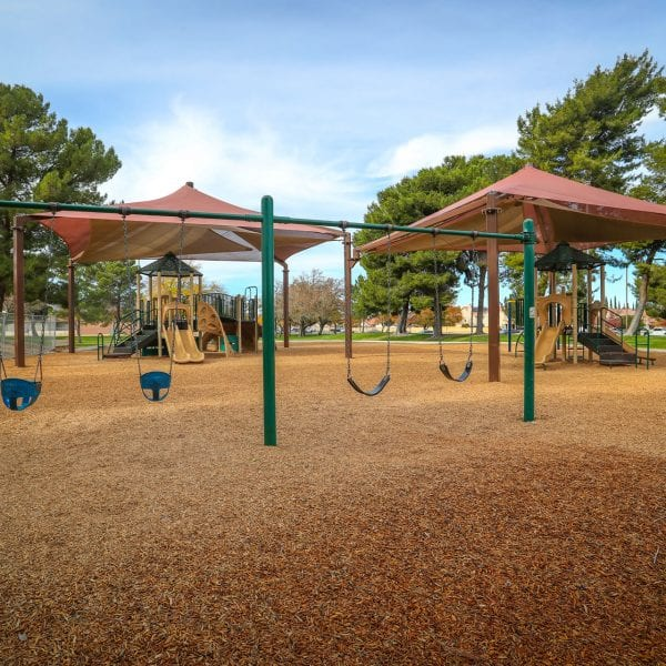 Two tent-covered playgrounds and swing set